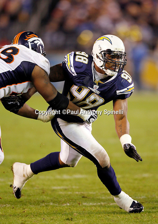 San Diego Chargers linebacker Antwan Barnes (98) works his way around a block during the NFL week 11 football game against the Denver Broncos on Monday, November 22, 2010 in San Diego, California. The Chargers won the game 35-14. (©Paul Anthony Spinelli)