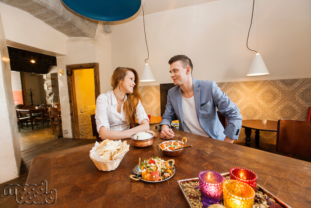 Young couple having food at restaurant