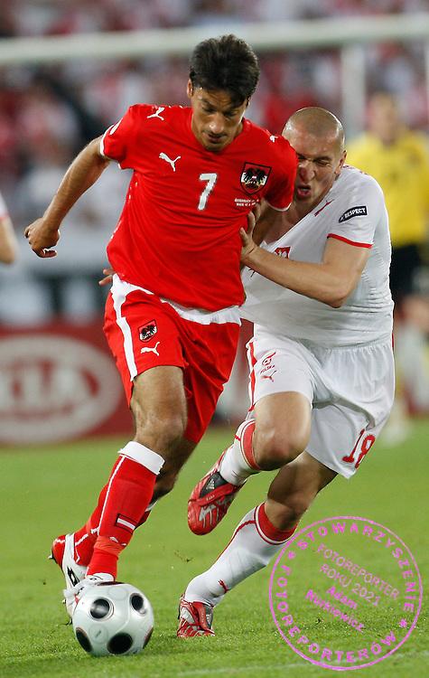 VIENNA 12/06/2008.Euro 2008 - Group B.AUSTRIA v POLAND.MARIUSZ LEWANDOWSKI OF POLAND BATTLES WITH IVICA VASTIC OF AUSTRIA ..*****************.FOT. PIOTR HAWALEJ / WROFOTO