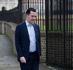 © London News Pictures. 18/03/2013 . London, UK.  British Chancellor of the Exchequer George Osbourne entering the back entrance to Downing Street. The Chancellor is due to announce the new budget on Wednesday. Photo credit : Ben Cawthra/LNP