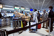 line with passengers at the luggage check in at Narita airport terminal for Lufthansa