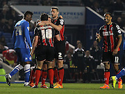 AFC Bournemouth striker Yann Kermorgant is congratulated after his opening goal during the Sky Bet Championship match between Brighton and Hove Albion and Bournemouth at the American Express Community Stadium, Brighton and Hove, England on 10 April 2015. Photo by Phil Duncan.