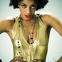 Fashion image of young female of African ethnicity wearing gold and jewellery