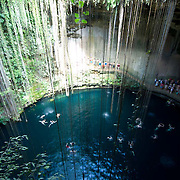People swiming on a Cenote well. Yucatan, Mexico.