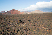 Malpais badlands volcanic landscape Parque Natural Los Volcanes, near Yaiza, Lanzarote, Canary islands, Spain - looking north east from Los Hervideros