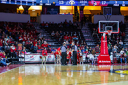 NORMAL, IL - December 07: Officials Gene Grimshaw, Jeff Malham and Randy Heimerman have a discussion during a time out standing in front of a facilities crew member that is setting up an alternative floor clock after the nearby backboard clock fails during a college basketball game between the ISU Redbirds and the Morehead State Eagles on December 07 2019 at Redbird Arena in Normal, IL. (Photo by Alan Look)