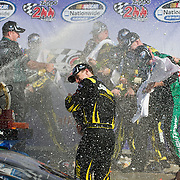 August 11, 2012: Nationwide Series driver Carl Edwards (60) has champagne showered on him by his crew after winning the Zippo 200 at the glen at Watkins Glen International speedway, Watkins Glen, New York.  (Credit Image: © Kostas Lymperopoulos/Cal Sport Media)