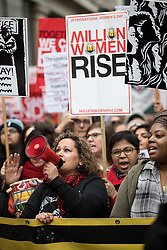 © Licensed to London News Pictures. 10/03/2018. London, UK. Activists take part in the 'Million Women Rise' march through central London, campaigning against domestic violence against women. Organisers have asked participants to wear red for the demonstration. On Thursday (8 March) this week, International Women's Day was celebrated. Photo credit : Tom Nicholson/LNP