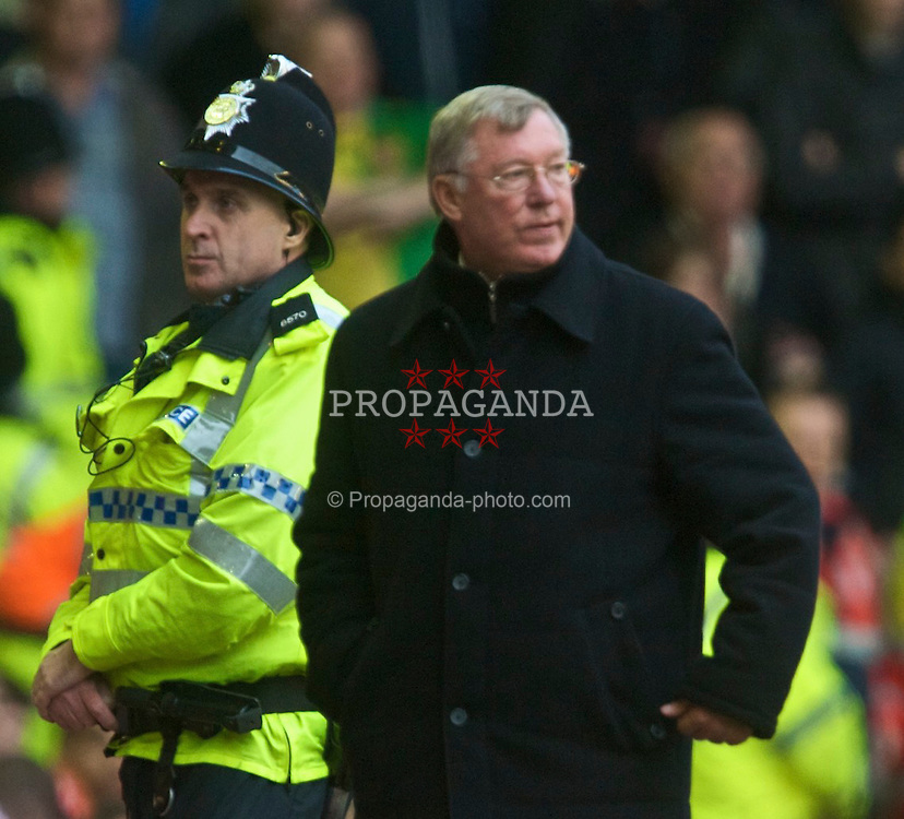 LIVERPOOL, ENGLAND - Sunday, October 25, 2009: Manchester United's manager Alex Ferguson and a police escort during the Premiership match at Anfield. (Photo by David Rawcliffe/Propaganda)