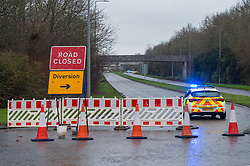 © Licensed to London News Pictures. 12/12/2019. Milton Keynes, UK. Police vehicles sit at road closures in the Fishermead area after a man was stabbed. Thames Valley Police has launched a murder investigation following the death of a man in Milton Keynes. Police and South Central Ambulance Service attended a woodland in Fishermead, Milton Keynes at around 15:20GMT on Wednesday 11th December 2019 after a report of an altercation between a group of men, during which a man had been stabbed. The victim, a man aged in his twenties died at the scene. Photo credit: Peter Manning/LNP
