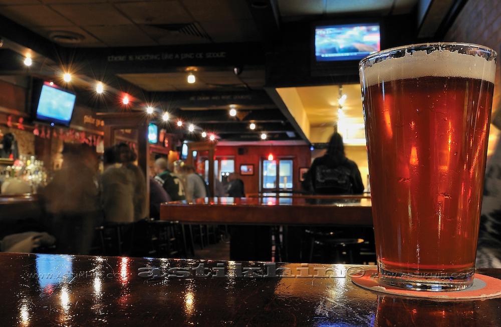 Glass of South Hampton Beer in Killarney Rose. Manhattan.
