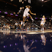 Moriah Jefferson, UConn, shoots past Makenzie Cann, Cincinnati, during the UConn Vs Cincinnati Quarterfinal Basketball game at the American Women's College Basketball Championships 2015 at Mohegan Sun Arena, Uncasville, Connecticut, USA. 7th March 2015. Photo Tim Clayton