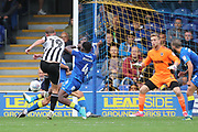 AFC Wimbledon defender Deji Oshilaja (4) making a block during the EFL Sky Bet League 1 match between AFC Wimbledon and Rochdale at the Cherry Red Records Stadium, Kingston, England on 30 September 2017. Photo by Matthew Redman.