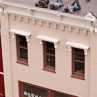 Construction workers lay on ledge of building to view the 2009 Veteran's Day Parade in downtown Knoxville.