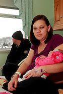 The first baby born in the area was a girl, Kailynn Stoltz at 1:33 a.m.  Her parents are Craig Stoltz (left) and Ashley Martin of  Dayton, photographed in their room at the Miami Valley Hospital's Berry Building, Tuesday, January 1, 2013.