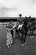 06/08/1987<br /> 08/06/1987<br /> 06 August 1987<br /> RDS Horse Show, Ballsbridge, Dublin. The Jameson Whiskey International. Picture shows Comandant Gerry Mullins on &quot;Limerick&quot;, winner of the  Jameson Whiskey International receiving the trophy from Marie Cummins and her husband Michael, Managing Director, Irish Distillers Sales Company.