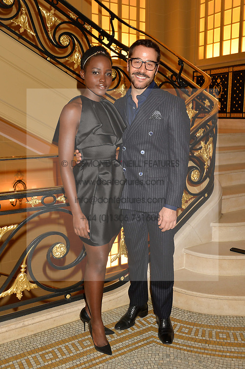 LUPITA NYONG'O and JEREMY PIVEN at the Sindika Dokolo Art Foundation Dinner held at The Cafe Royal, Regent Street, London on 18th October 2014.