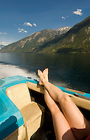 A woman's legs are all that is seen on this fast boat ride on Anderson Lake, BC Canada