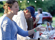 Handing out samples at the Bellyfire Catering booth during the 21st annual The Taste in the Lincoln Park Commons area at the Fraze Pavilion, Thursday, September 3, 2009.