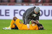 Dolly Menga (#45) of Livingston FC is injured during the 4th round of the William Hill Scottish Cup match between Heart of Midlothian and Livingston at Tynecastle Stadium, Edinburgh, Scotland on 20 January 2019.