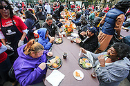 People enjoy their Thanksgiving meal on Wednesday November 25, 2015, in Los Angeles. Thousands of Skid Row residents and homeless people from downtown and beyond were served Thanksgiving dinners during the Los Angeles Mission's annual holiday feast. (Photo by Ringo Chiu/PHOTOFORMULA.com)<br /> <br /> Usage Notes: This content is intended for editorial use only. For other uses, additional clearances may be required.