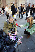 Vienna, Austria. Marie Cochon is a pig feeding on (and stuffed out with) fake money named honey, protesting against greed and corruption in contemporary politics. During her performance, she's assistet by artists Nikolaus (here being interviewed) and Barbara Eberstaller..http://www.marie-cochon.com