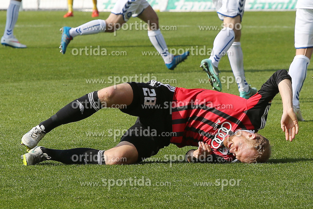 15.03.2015, Audi Sportpark, Ingolstadt, GER, 2. FBL, FC Ingolstadt 04 vs Karlsruher SC, 25. Runde, im Bild Tobias Levels (Nr.28, FC Ingolstadt 04) nach Foul am Boden // during the 2nd German Bundesliga 25th round match between FC Ingolstadt 04 and Karlsruher SC at the Audi Sportpark in Ingolstadt, Germany on 2015/03/15. EXPA Pictures &copy; 2015, PhotoCredit: EXPA/ Eibner-Pressefoto/ Strisch<br /> <br /> *****ATTENTION - OUT of GER*****