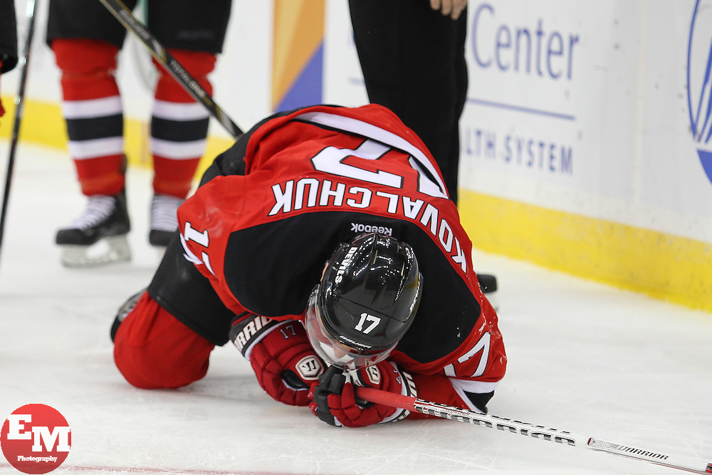 Mar 23, 2013; Newark, NJ, USA; New Jersey Devils right wing Ilya Kovalchuk (17) is injured during the third period at the Prudential Center. The Devils defeated the Panthers 2-1.