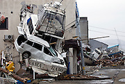 Photo shows a yacht that was driven into a building by the force of the tsunami that followed the March 11 magnitude 9 quake in Ishinomaki, Miyagi Prefecture on 15 March, 2011. Photographer: Robert Gilhooly