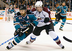 April 16, 2010; San Jose, CA, USA; San Jose Sharks defenseman Dan Boyle (22) controls the puck while being defended by Colorado Avalanche center Matt Duchene (right) during the first period of game two in the first round of the 2010 Stanley Cup Playoffs at HP Pavilion.  The Sharks defeated the Avalanche 6-5 in overtime. Mandatory Credit: Jason O. Watson / US PRESSWIRE