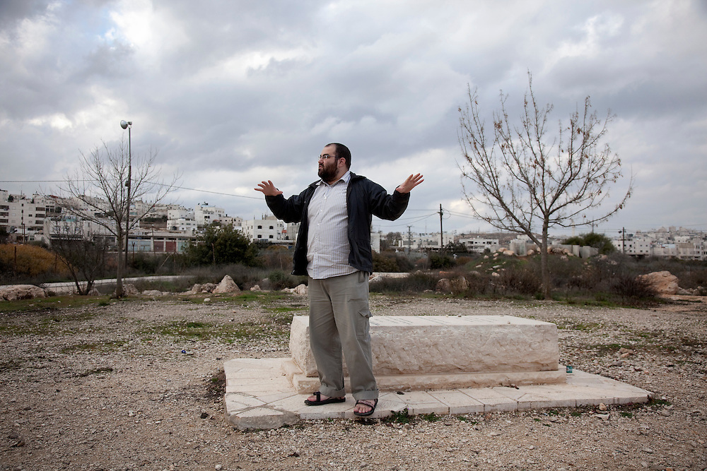 Yehuda Sheul, a former IDF soldier and co-founder of the Breaking the Silence organization standing at the gravesite of Baruch Goldstein in Hebron.  On February 25 in 1994 Baruch Goldstein, an Israeli settler and member of the extremist Kach movement, opened fire on unarmed worshipers, killing between 39 and 52 Palestinians and wounding over hundred.