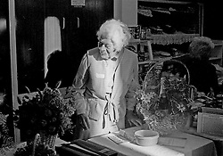 Picture by Mark Larner. Picture shows an old lady on the dreid flower stall at the Oxshott Women's Institute Christmas Fair at the village hall. 1994