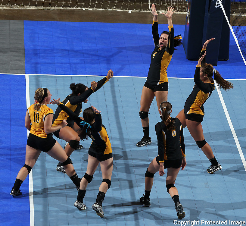 Janesville celebrates after a score during the second game of their 1A semifinal match in the state volleyball tournament at the U.S. Cellular Center at 370 1st Ave E on Friday evening, November 12, 2010. (Stephen Mally/Freelance)