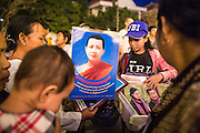 "30 JANUARY 2013 - PHNOM PENH, CAMBODIA:   People buy portraits of the late Cambodian King Norodom Sihanouk in Phnom Penh. Sihanouk (31 October 1922 - 15 October 2012) was the King of Cambodia from 1941 to 1955 and again from 1993 to 2004. He was the effective ruler of Cambodia from 1953 to 1970. After his second abdication in 2004, he was given the honorific of ""The King-Father of Cambodia."" Sihanouk held so many positions since 1941 that the Guinness Book of World Records identifies him as the politician who has served the world's greatest variety of political offices. These included two terms as king, two as sovereign prince, one as president, two as prime minister, as well as numerous positions as leader of various governments-in-exile. He served as puppet head of state for the Khmer Rouge government in 1975-1976. Most of these positions were only honorific, including the last position as constitutional king of Cambodia. Sihanouk's actual period of effective rule over Cambodia was from 9 November 1953, when Cambodia gained its independence from France, until 18 March 1970, when General Lon Nol and the National Assembly deposed him. Upon his final abdication, the Cambodian throne council appointed Norodom Sihamoni, one of Sihanouk's sons, as the new king. Sihanouk died in Beijing, China, where he was receiving medical care, on Oct. 15, 2012. His cremation is scheduled to take place on Feb. 4, 2013. Over a million people are expected to attend the service.        PHOTO BY JACK KURTZ"