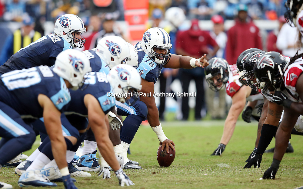 Tennessee Titans offensive tackle Jamon Meredith (79) points at the defense as the Titans offensive line gets set to snap the ball opposite the Tennessee Titans defensive line at the line of scrimmage during the 2015 week 7 regular season NFL football game against the Atlanta Falcons on Sunday, Oct. 25, 2015 in Nashville, Tenn. The Falcons won the game 10-7. (©Paul Anthony Spinelli)