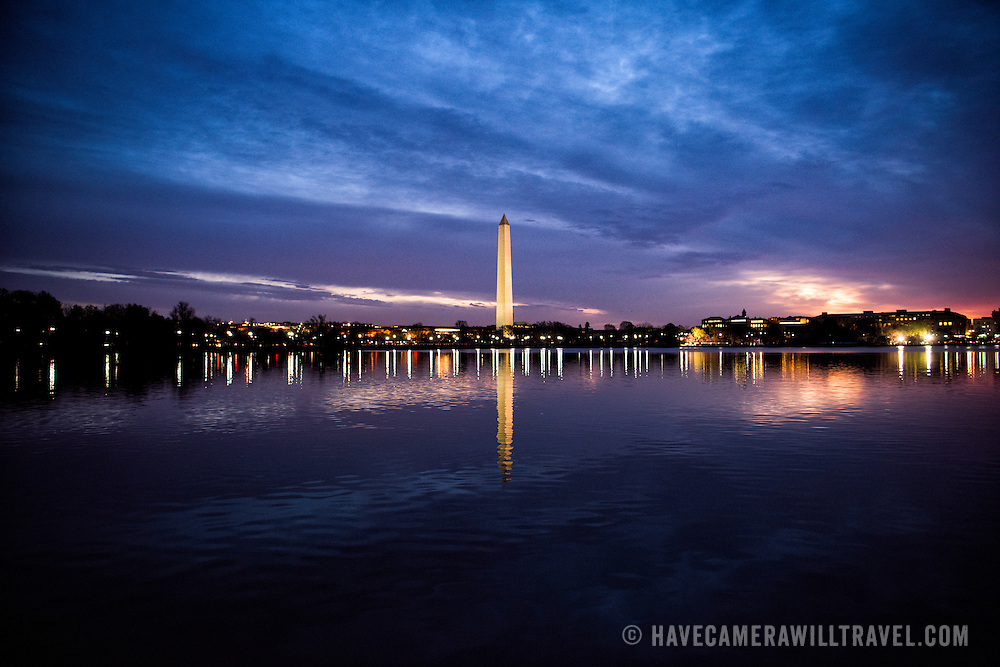 Washington DC--Colorful skies before dawn on a still spring morning in Washington DC, with the Washington Monument in the center of frame.