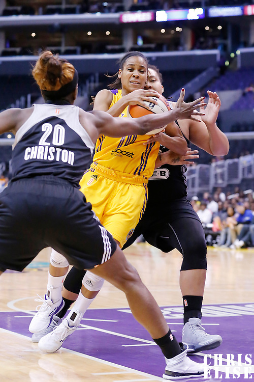 25 May 2014: Los Angeles Sparks guard Lindsey Harding (10) drives past San Antonio Stars forward/center Danielle Adams (23) and San Antonio Stars forward Shameka Christon (20) during the Los Angeles Sparks 83-62 victory over the San Antonio Stars, at the Staples Center, Los Angeles, California, USA.