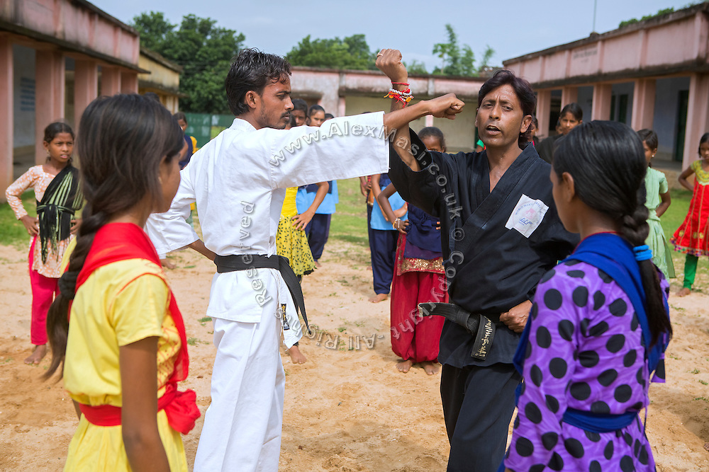 Tabasum Khatun, 14, and her best friend Anju Kumari, 13, (right) are observing a Karate counter-attack move during a class in Algunda village, pop. 1000, Giridih District, rural Jharkhand, India.