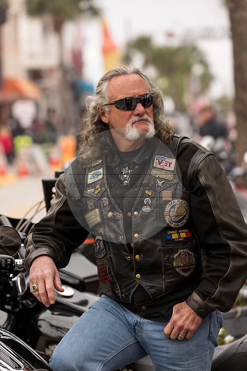 A bearded biker on Main Street during the 74th Annual Daytona Bike Week March 7, 2015 in Daytona Beach, Florida.