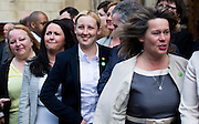 UNITED KINGDOM, London: 11 May 2015. Mhairi Black MP for Paisley and Renfrewshire South is photographed along with First Minister of Scotland, Nicola Sturgeon (not pictured) out side the House's of Parliament with all 56 newly elected Scottish National Party MP's out side the House's of Parliament for a photo-call. London, England. Andrew Cowie / Story Picture Agency