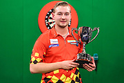 Dimitri Van den Bergh with the winners trophy during the PDC Unicorn World Youth Championship Final at Butlins Minehead, Minehead, United Kingdom on 26 November 2017. Photo by Shane Healey.