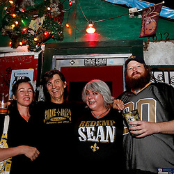8/14/2013 7:32:55 PM -- New Orleans, LA  Saints fans (left to right) Kathleen McDonald and David Clements and Lori Cavagnaro and Rhys Cook pose outside of the Snake and Jakes bar -- Saints rebirth with the return of Head Coach Sean Payton --    Photo by Derick E. Hingle , Gannett