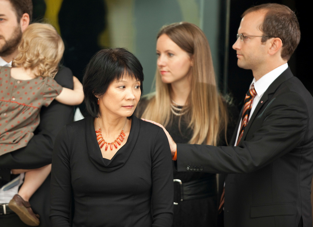 Toronto, Ontario ---11-08-27--- Mike Layton, son of Jack Layton, gestures to his step-mother, Olivia Chow, following a state funeral for the late NDP leader in Toronto, Ontario, August 27, 2011. <br /> AFP/GEOFF ROBINS/STR
