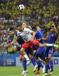 KAZAN, June 24, 2018  Maciej Rybus (2nd L) of Poland competes for a header during the 2018 FIFA World Cup Group H match between Poland and Colombia in Kazan, Russia, June 24, 2018. Colombia won 3-0. (Credit Image: © He Canling/Xinhua via ZUMA Wire)