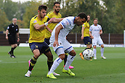 Andy Barcham of AFC Wimbledon is hounded by George Baldock during the Sky Bet League 2 match between Oxford United and AFC Wimbledon at The Kassam Stadium, Oxford, England on 10 October 2015. Photo by Stuart Butcher.