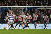 QPR defender Jake Bidwell (3) takes a shot on goal during the EFL Sky Bet Championship match between Queens Park Rangers and Brentford at the Loftus Road Stadium, London, England on 10 November 2018.