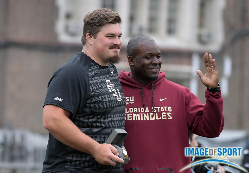 Apr 27, 2018; Philadelphia, PA, USA; Austin Droogsma of Florida State (left) poses with throws coach Dorian Scott after winning the shot put during the 124th Penn Relays at Franklin Field.