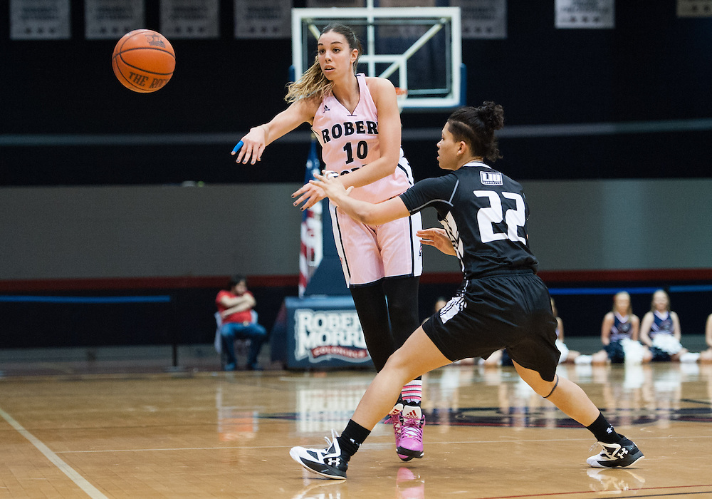 February 22 2016: Robert Morris Colonials guard Rebeca Navarro (10) makes a pass while being guarded by Long Island Blackbirds guard Brianna Farris (22) during the first half in the NCAA Women's Basketball game between the Long Island Blackbirds and the Robert Morris Colonials at the Charles L. Sewall Center in Moon Township, Pennsylvania (Photo by Justin Berl)