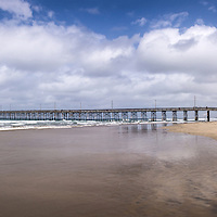 Panoramic photo of Newport Pier in Newport Beach California. Newport Pier is a popular local attraction located on Balboa Peninsula. Newport Beach is a wealthy beach city located in upscale Orange County in Southern California. The photo was taken in 2012 and has a panoramic raito of 16:7.
