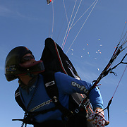 149 of the World's best paragliding pilots from 39 nations descended on the small country town of Manilla near Tamworth in northern New South Wales, Australia to contest the 10th FAI Paragliding World Championships during March 2007. The drought stricken area is renowned for it's great cross country flying from the Mount Borah hillside and over two hectic weeks, numerous incidents and mixed weather, the pilots were able to fly five tasks to decide the winners in what proved to be an extremely close contest.. The Men's competition was won by Great British pilot Bruce Goldsmith with Jean-Marc Caron of France finishing second just seventeen points behind with Thomas Mccune of USA finishing third. The women's competition was won by Petra Slivova of Czech Republic with Viv Williams of Australian just fifteen points behind and New Zealand pilot Harmony Gaw finishing third. .In the team event Czech Republic finished first followed by France and Switzerland...Pilots take to the skies during competition where they form gaggle's and look for the best lift from thermal's....